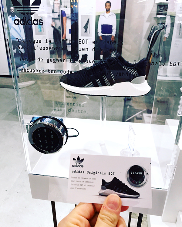 Scratch card to win Adidas Trainers concealed inside a glass box