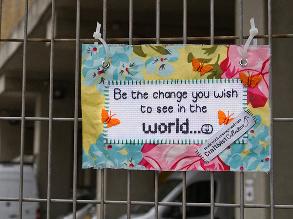 Banner stating: Be the change you wish to see in the world
