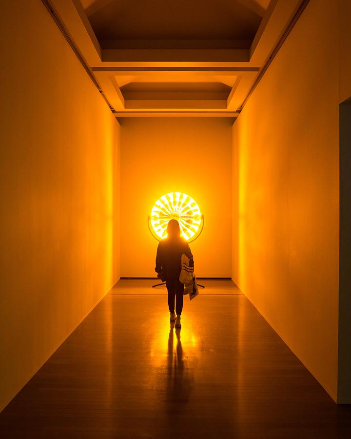 woman walking towards light